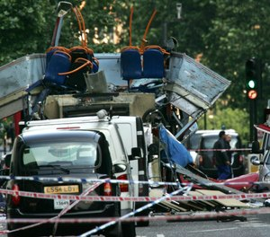 In this file photo dated July 7, 2005, the wreckage of a double-decker London bus with its top blown off and damaged cars scattered on the road at Tavistock Square in central London.