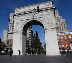 Pedestrians pass the arch in Washington Square park Thursday, Jan. 10, 2013, in New York.