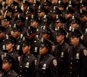 Department of Correction graduating officers participate in the Promotion and Recruit Graduation Ceremony, Friday, Feb. 13, 2015, in the Bronx borough of New York.