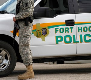 A U.S. Army police officer stands patrol in Fort Hood, Texas.