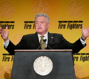 International Association of Fire Fighters President Harold A. Schaitberger speaks at the IAFF Legislative Conference and Presidential Forum in 2015. The IAFF has concluded its internal investigation into allegations of financial misconduct by Schaitberger, stating Schaitberger was not at fault for any alleged pension overpayments.