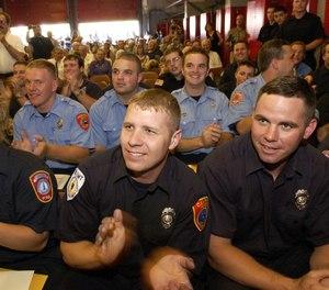 Graduates applaud at The Massachusetts Firefighting Academy as Recruit Class #151, graduates Friday, June 21, 2002, in Stowe, Mass. (AP Photo/Michael Manning)