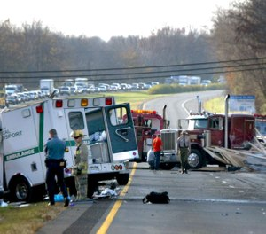 Howard County police and rescue workers examine the scene of a fatal accident Thursday, Nov. 18, 2004, on westbound Interstate 70 at U.S. 29 in Ellicott City, Md. (AP Photo/Matt Houston)