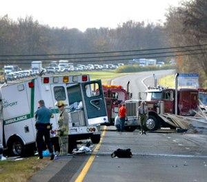 Howard County police and rescue workers examine the scene of a fatal accident Thursday, Nov. 18, 2004, on westbound Interstate 70 at U.S. 29 in Ellicott City, Md.