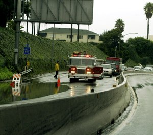 A firetruck blocks the partially flooded I-10 Highway Monday, Jan. 10, 2005, in Santa Monica, Calif. (AP Photo/Damian Dovarganes)