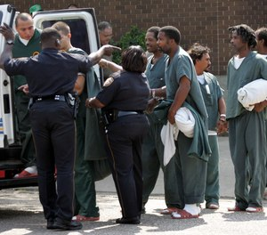 Prisoner transport training should address all scenarios including the evacuation of prisoners. In this photo, prisoners from the Galveston County Jail are evacuated as Hurricane Rita heads for the Texas Gulf Coast Thursday, Sept. 22, 2005 in Galveston, Texas. (AP Photo/David J. Phillip)