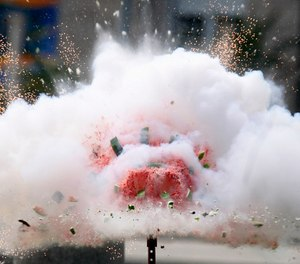 The Consumer Product Safety Commission sets off fireworks inside of a watermelon to demonstrate the dangers of fireworks and encourage safety on July 4. (AP Photo/Jacquelyn Martin)