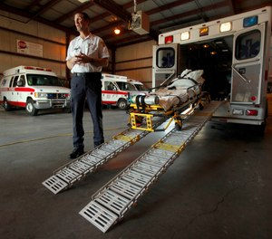 In this photo taken Aug. 7, 2009, American Medical Response operations manager Ken Keller talks about the specially-equipped ambulance used for obese patients at the company's Topeka, Kan. facility. (AP Photo/Charlie Riedel)