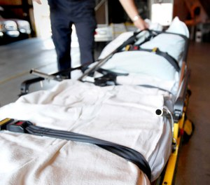 In this photo taken Aug. 7, 2009, American Medical Response supervisor Bill Beasley loads a heavy duty gurney rated at 1,600 pounds into a specially-equipped ambulance used for obese patients at the company's Topeka, Kan. facility. (AP Photo/Charlie Riedel)