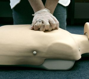 In this Sept. 15, 2006 file photo, a person participates in an American Red Cross CPR training in Washington. A team of researchers and physicians have created a method to improve cardiac arrest outcomes through a clinical analysis of recorded CPR cases.