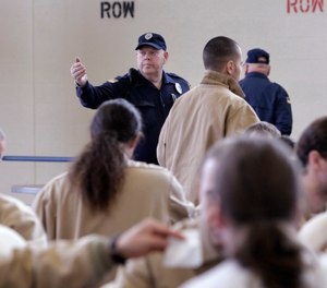 The mess hall can be one of the most dangerous locations for both staff and inmates. (AP Photo/Elaine Thompson)