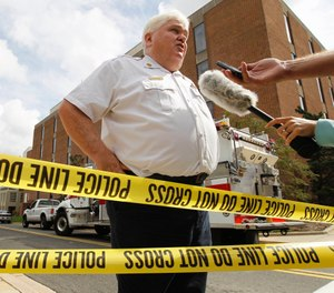 Mark Brady speaks to the media after an explosion at the University of Maryland chemistry building in 2011. The longtime spokesman of the Prince George's County Fire Department retired last week after 26 years. (AP Photo/Jose Luis Magana)