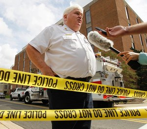 Mark Brady speaks to the media after an explosion at the University of Maryland chemistry building in 2011. The longtime spokesman of the Prince George's County Fire Department retired last week after 26 years.