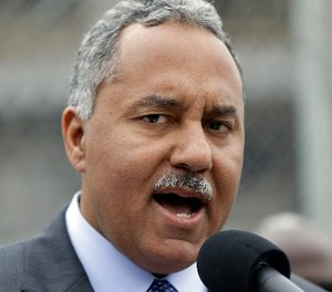 New Orleans Sheriff Marlin Gusman speaks to reporters at a news conference outside the construction site of new jail facilities in New Orleans, Thursday, April 4, 2013. (AP Photo/Gerald Herbert)