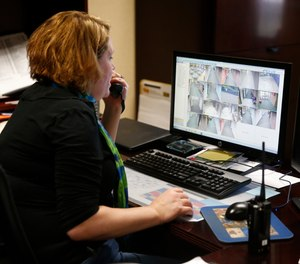 In this May 6, 2016, photo, Forest Dale Elementary School administrative assistant Heather Fellabaum tracks an
