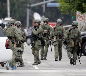 An FBI SWAT team arrives at the scene of a fatal shooting at the University of California, Los Angeles, Wednesday, June 1, 2016, in Los Angeles.