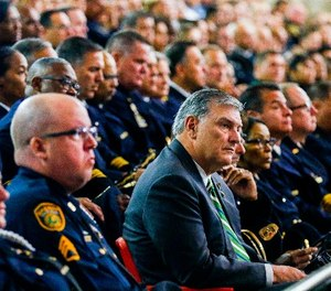 Dallas Mayor Mike Rawlings is surrounded by police officers during a funeral service for Dallas police officer Patrick Zamarripa on Saturday, July 16, 2016, at Wilkerson-Greines Athletic Center in Fort Worth, Texas. (Ashley Landis /The Dallas Morning News via AP, Pool)