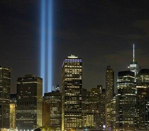 The Tribute in Light rises above the lower Manhattan skyline in New York. (Photo/AP, Mark Lennihan)