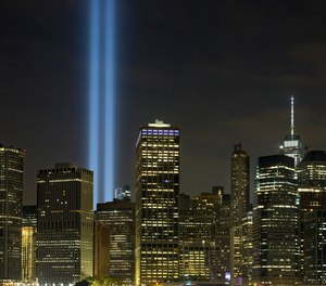 The Tribute in Light rises above the lower Manhattan skyline in New York.