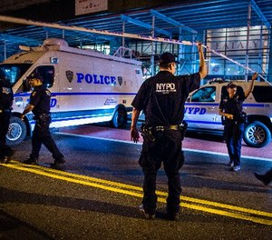 Police arrive on the scene of an explosion in Manhattan's Chelsea neighborhood, in New York, Saturday, Sept. 17, 2016. (AP Photo/Andres Kudacki)
