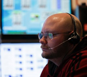 Dispatchers are the starting point to the important work of obtaining essential information. (AP Photo/Mike Groll)