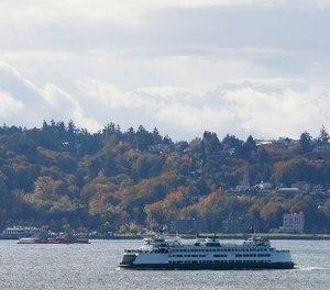 A Washington state ferry sails on Elliott Bay near West Seattle, Tuesday, Oct. 18, 2016, in Seattle.
