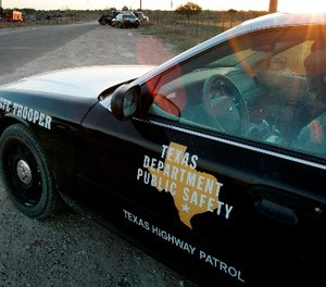 In this April 6, 2008, file photo, a Texas State Trooper is shown sitting in his vehicle in Eldorado, Texas.