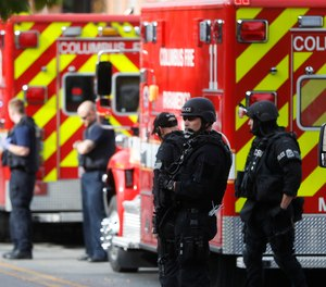 SWAT teams and police respond to reports of a shooting on campus at Ohio State University, Monday, Nov. 28, 2016, in Columbus, Ohio.
