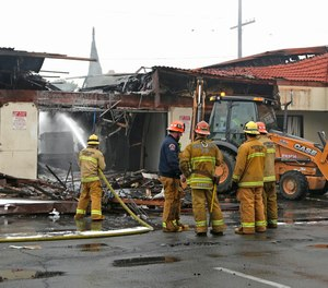 Firefighters battle a four-alarm fire at a strip mall in Monterey Park, Thursday, Dec. 15, 2016.