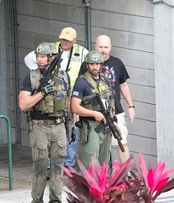 Law enforcement personnel are shown outside a garage area at Fort Lauderdale–Hollywood International Airport, Friday, Jan. 6, 2017, in Fort Lauderdale, Fla., after a shooter opened fire inside a terminal of the airport, killing several people and wounding others before being taken into custody.