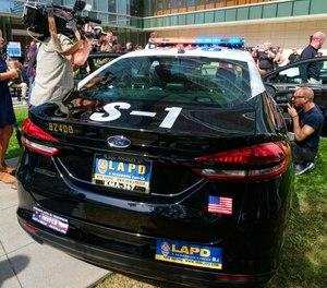 A prototype of the Ford Fusion police hybrid car is pictured at LAPD headquarters. The U.S. Department of Energy has funding options for PDs considering adding alternative-fuel vehicles to their fleet. (AP Photo/Richard Vogel)