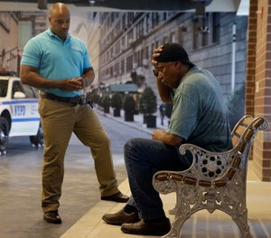 New York City Police Officer Lamont Edwards talks to actor Nathan Purdee during a Crisis Intervention Training class at the New York Police Department Police Academy.
