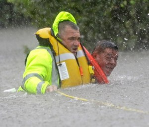 Floodwaters present an especially hazardous environment for emergency responders as those floodwaters likely contain human and animal waste, petroleum productsand chemicals. (Photo/AP)
