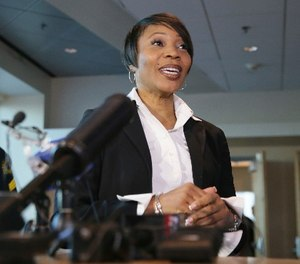 Dallas Police Chief Reneé Hall talks to reporters during an applicant processing event at police headquarters in Dallas, Thursday, Sept. 7, 2017.