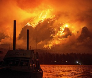 A teen who started a massive wildfire in Oregon has been ordered by a judge to pay nearly $37 million over the next decade. (Photo/AP)