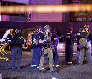 Police officers and medical personnel stand at the scene of the Las Vegas shooting.