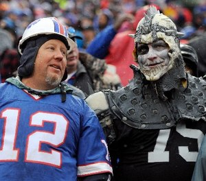 Spectators converse during the first half of an NFL football game between the Buffalo Bills and the Oakland Raiders, Sunday, Oct. 29, 2017, in Orchard Park, N.J.