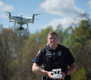 In this Oct. 16, 2017 photo, Streetsboro Officer Scott Hermon pilots the department's first drone in Streetsboro, Ohio.