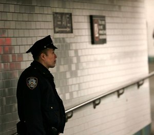 A police officer patrols in the passageway connecting New York City's Port Authority bus terminal and the Times Square subway station Tuesday, Dec. 12, 2017.