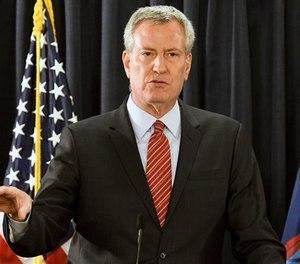New York City Mayor Bill de Blasio speaks with reporters on Wednesday, Jan. 3, 2018, in Albany, N.Y. (AP Photo/Hans Pennink)
