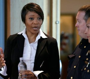 In this Sept. 7, 2017 photo, new Dallas Police Chief U. Reneé Hall talks during an applicant processing event at police headquarters in Dallas. (AP Photo/LM Otero, File)