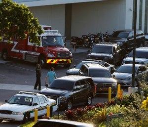 Police and rescue vehicles are shown outside Broward Health North hospital, Wednesday, Feb. 14, 2018, in Deerfield Beach, Fla. (AP Photo/Joe Skipper)