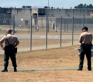 Correctional officers keep watch on inmates in the recreation yard at Pelican Bay State Prison near Crescent City, Calif. Gov. (AP Photo/Rich Pedroncelli)