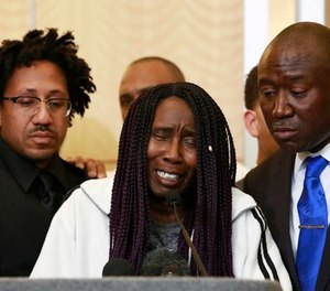 Sequita Thompson, center, discusses the shooting of her grandson, Stephon Clark, during a news conference, Monday, March 26, 2018, in Sacramento, Calif.