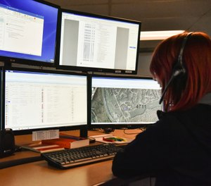 A dispatcher in Roswell, Ga., works with a variety of screens while handling a 911 call. The Roswell call center is one of the few in the United States that accepts text messages. (AP Photo/Lisa Marie Pane)