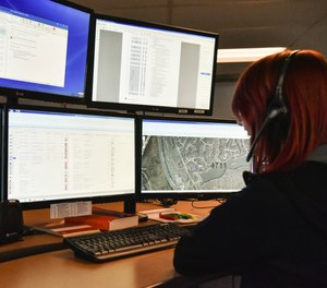 A dispatcher in Roswell, Ga., works with a variety of screens while handling a 911 call. The Roswell call center is one of the few in the United States that accepts text messages.