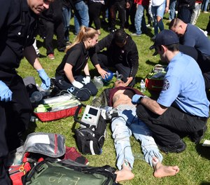 An unconscious man is attended to by paramedics San Francisco, Calif., on Friday, April 20, 2018. (AP Photo/Josh Edelson)