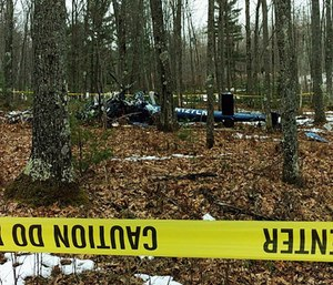This image provided by the Oneida County Sheriff's Office in Rhinelander, Wis., shows the wreckage of the medical helicopter.