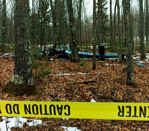 This image shows the wreckage of the Air Methods helicopter that crashed in Hazelhurst, Wis. in 2018.