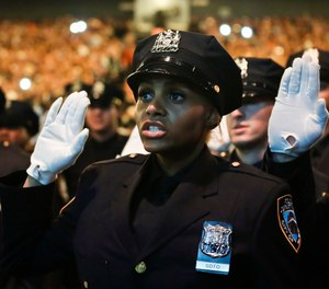 Members of New York Police Academy's July 2018 graduating class of 726 new NYPD police officers, pledge the Oath of Office during graduation ceremony, Monday July 2, 2018, in New York.